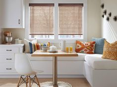 These aluminum blinds really tie this room together, don't you think? Visit our website or give us a call at to see how our window treatments can accentuate your home! Dining Sofa, White Dining Chairs, Pedestal Dining Table, High Chairs, Aluminum Blinds, Plastic Dining Chairs, Custom Shutters, Woven Wood Shades, Fire Pit Table And Chairs