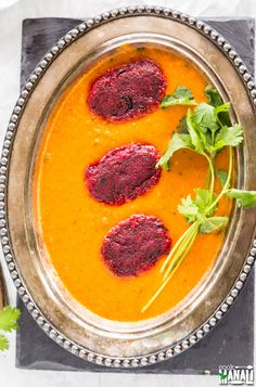 Soft beetroot kofta served on top of a creamy tomato curry. Great with naan or rice! Find the recipe on www.cookwithmanali.com