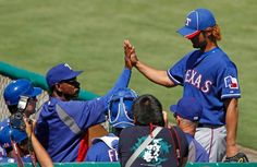 Texas starting pitcher Yu Darvish (11) gets a high five from manager Ron Washington after finishing his four innings during the Texas Rangers vs. the Frisco Roughriders exhibition baseball game at the Dr. Pepper Ballpark in Frisco on Wednesday,April 4, 2012.