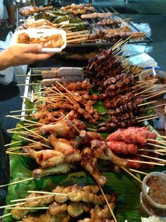 Hot skewers and humid nights on the streets of Bangkok, Thailand.