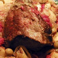 Boliche - Cuban Pot Roast...: INGREDIENTS: 3-4 pound Chuck or Rump roast 6 links Spanish chorizo 7 garlic cloves, mashed 1 teaspoon salt 1/2 teaspoon pepper 1 can diced tomatoes 1 tablespoon oregano 1/4 cup olive oil 1 large onion sliced 4 medium potatoes quartered 1/4 cup green olives 1/2 cup red wine 1 cup water