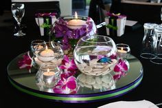 Table centerpiece, mirror glass bowls candles Siamese fighting fish purple orchid