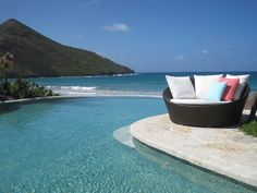 Fabulous island lifestyle at Christophe Harbor's Pavilion in St. Kitts. Gorgeous view of infinity pool transition to ocean.