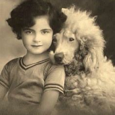 Little girl poses with the white standard poodle. I think this is one of my favorites of all that I have pinned.