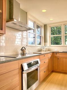 Beige Subway Tile Kitchen Traditional with Backsplash Green Hardwood Floor