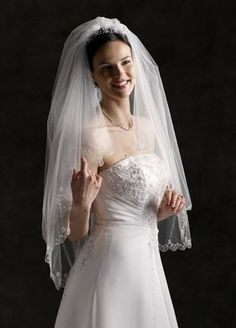 David's Bridal Fingertip Length Two-Tier Veil with Scallop Edge Style 689, Ivory David's Bridal. $189.00