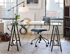 glass top desk with sawhorses