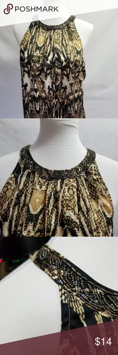 Worthington Halter Blouse Women's Size Large Worthington Women's Halter Blouse Women's Halter Top Women's Size Large Black & Tan Print Beaded Neckline Very Good Used Condition Measurements Bust 40 inches Length 27 inches Worthington Tops