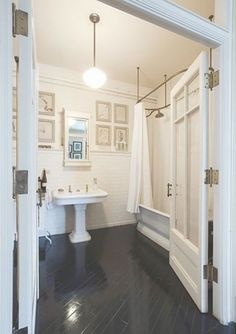 French doors, white, hardware,dark wood floors. Love this bathroom's style, but the doors have glass... not exactly private!