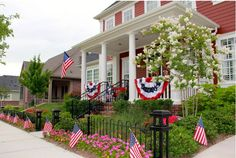 July 4th decor among beautiful floral landscaping at this Tucker Hill home (McKinney, TX) www.tuckerhilltx.com