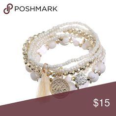 Stack bohemian luxe bracelet with tassel Stacks bohemian luxe bracelet . Classy White  earth Jewelry Bracelets