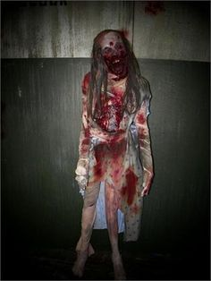 FEMALE TRIAGE ZOMBIE - Full Size Haunted House Prop