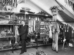 Clark Wissler in the Plains Indians storage room, American Museum of Natural History, ca. 1914.