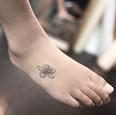 Black and grey ink cherry blossom tattoo on foot by Hongdam