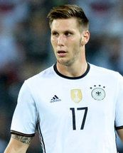 Arsenal Spurs and Everton scout Germany international defender