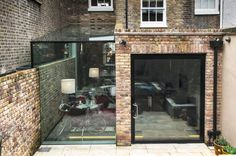 Browse images of modern Houses designs: Pivot Door and Frameless Glass Box Extension. Find the best photos for ideas & inspiration to create your perfect home.