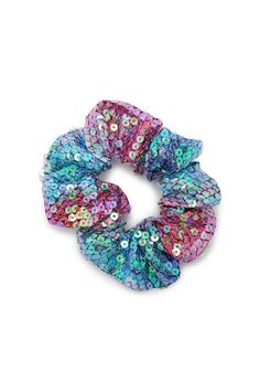 A woven scrunchie featuring an elasticized body and rainbow ombre fabric.