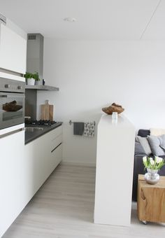 again, white with light warm gray wood floors