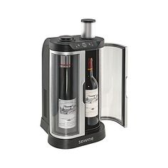 """SoWine Home Wine Bar at Wine Enthusiast - $395.00 - """"chills and preserves opened wine for up to 10 days [...] No Stoppers, pumps or gases required"""" A great gift for a wine enthusiast"""