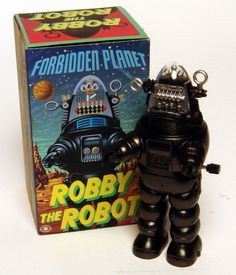 This Robby the Robot was made in Japan in 1997 by Modern Toys for Rocket USA. About 4.3 inches tall, when wound it lumbers forward. Small price tag on rear of box.