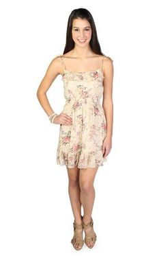 I have a dress just like this. It is super cute when paired with a brown belt and gold accessories. I love it.