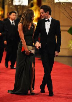 Actor Eddie Redmayne (R) and Hannah Bagshawe depart the Oscars at Hollywood & Highland Center on February 24, 2013 in Hollywood, California