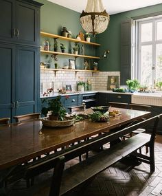 Classic blue kitchen in a Victorian rectory with terracotta floor and green wall. Classic blue kitchen in a Victorian rectory with terracotta floor and green wall. Classic Kitchen, New Kitchen, Rustic Kitchen, Kitchen Island, Copper In Kitchen, Earthy Kitchen, 1920s Kitchen, Bistro Kitchen, Crazy Kitchen