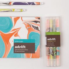 "Galison's Adrift Everyday Pen Set includes three pens decorated with on-trend marbled designs by artist Natalie Stopka, and is a visually stunning addition to any home office. - 3 black ballpoint pens, 3 Designs - Full color printed barrels - Packaged in acetate box - Package size: 1.5 x 6 x 5/8"", 44 x 162 x 14mm From the Adrift Collection"