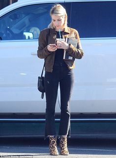 Chilly chic: The 26-year-old paired her fierce footwear with a brown, distressed leather j...