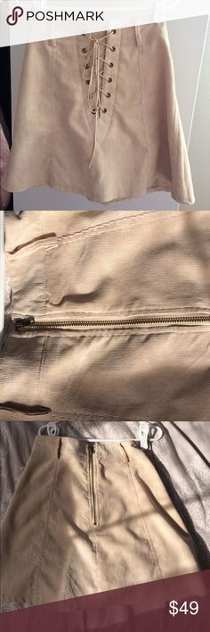 LF Tan Lace Up Skirt Super cute tan skirt from LF. No flaws only worn a few times. Open to offers! LF Skirts Mini