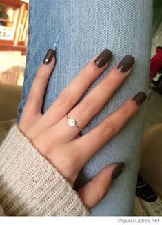 Long gel nails with a silver ring