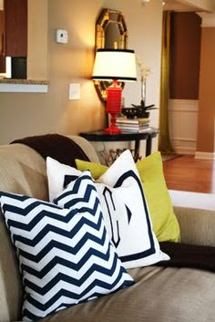 Living room, chevron pillow, monogrammed pillow (these are awesome and would go great with your couch-with a clean/pretty gallery wall around the tv!)