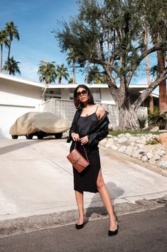 storm wears jw anderson brown bag with dolce vita mules and edited the label skirt in palm springs