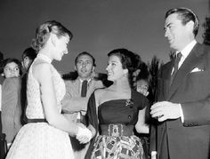 Audrey Hepburn and Gregory Peck meet Italian actress Silvana Pampanini in Rome in June 1952. Hepburn and Peck were there to begin filming Roman Holiday.