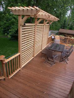 Deck - privacy idea with added touch for hanging plants and lights