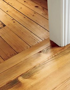 Restoring an 1860 Farmhouse in New Jersey - Country Living. Reclaimed antique hemlock flooring used in the new addition meets the original floors (shown at top).