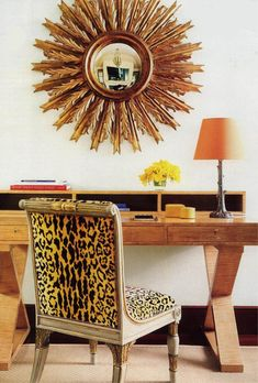 another example of balance. wood desk, antique chair, leopard print, gold mirror, orange lampshade, yellow flowers. It all goes together.