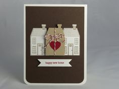Congratulate a new homeowner with a handmade new home card. This brown and white card features hand-stamped images of three houses; the center