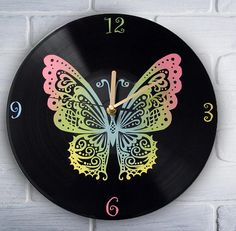 Pastel colored butterfly. Painted vinyl record clock.