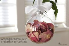 Wedding Memories! Put petals from bouquet into a clear ornament and tie with ribbon from the wedding.