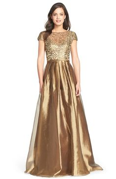 "Free shipping and returns on Theia Mixed Media Ballgown at Nordstrom.com. Bring new meaning to ""bronzed goddess"" in this lustrous metallic gown textured in embroidered lace and wispy tulle."
