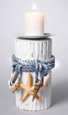 Love the blue rope tied around a white candle holder