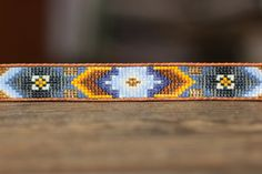 Loving tribal patterns! Loom beaded leather bracelet from LeiselHandmade on Etsy