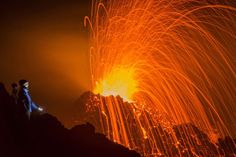 A person looks at the Piton de la Fournaise volcano in eruption Thursday, Feb. 5, 2015, in the Frenc... - Fabrice Wislez/AP