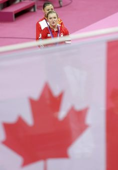 Canada's gold medallist Rosannagh Maclennan walks followed by China's bronze medallist He Wenna after the medal ceremony for the women's trampoline at the 2012 Summer Olympics, Saturday, Aug. 4, 2012, in London.