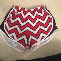 VARSITY athletic shorts They fit much like tempo shorts! This unique chevron pattern is a complement hog!! They are so comfortable and only been worn twice. They were the camp shorts we wore in cheerleading. Let me know if you have any questions about this item or world like to see them modeled! Varsity Shorts
