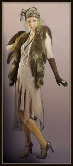Dusty pink chiffon 1920s style dress with fox boa and accessories from The Costume Shop.