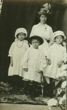 Antique real photo postcard - young mother with her brood, circa 1910.
