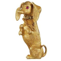 # CARTIER Adorable #Dachshund #Brooch. Italy 1950's Cartier very adorable 18k gold Dashound brooch with facted ruby eyes and chain collar.
