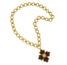 A Wood, Diamond and Gold Flower Pendant Necklace, by Van Cleef & Arpels, circa 1970. Via FD Gallery, www.fd-inspired.com